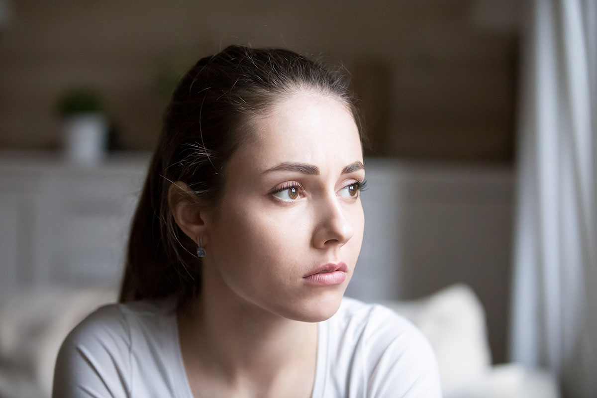 Woman staring off thinking Is My Loved One an Alcoholic?