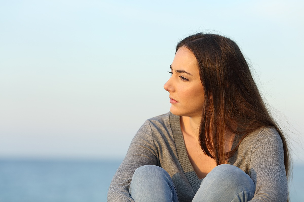 woman looking out over sea dealing with benzos and alcohol
